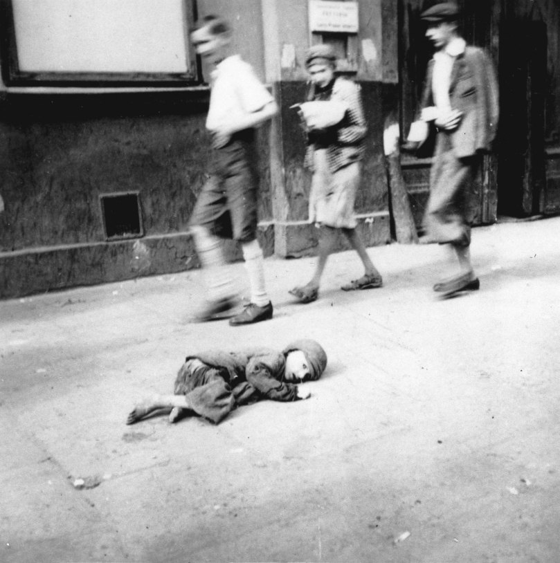 A starving, helpless child lies on the streets of the Warsaw Ghetto, Sep 1941